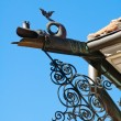 Ancient drainpipe in the form of a dragon — Stock Photo #38759459