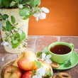 Cup of tea with an apple — Stock Photo #38759491