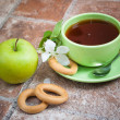 Cup of tea with an apple — Stock Photo #38759501