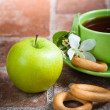 Cup of tea with an apple — Stock Photo #38759503