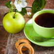 Cup of tea with an apple — Stock Photo #38759517