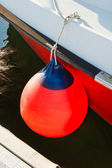 Round buoy with a monolithic eye at a board of the moored yacht — Stock Photo