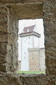 View of the castle through a window in the wall — Stock Photo