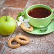 Stock Photo: Cup of tea with an apple