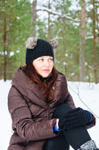 Portrait of the charming young woman in winter outdoors — Stock Photo