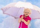Portrait of the little girl under a umbrella — Stock Photo