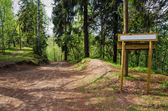 Wooden sign board on the natural trail. In the — Stock Photo