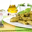 Pasta with italian pesto sauce - Stock Photo