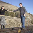 Stock Photo: Couple on the train tracks