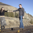 Couple on the train tracks — Stock Photo