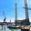 Offshore drilling platform in repair in shipyard — Stock Photo