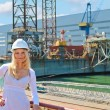 Stock Photo: Woman engineer shipbuilder at the shipyard.