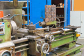 Old lathe in workshop of the plant — Stock Photo