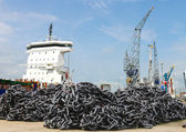 A pile of anchor chain at a shipyard — Stock Photo