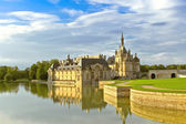 Castle of Chantilly at sunset. France — Stock Photo