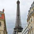 Stock Photo: Parisistreet against Eiffel Tower in Paris. France