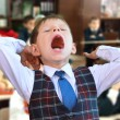 Kid yawning at the lesson — Stock Photo
