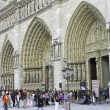 Tourists near Notre Dame de Paris. France - Stock Photo