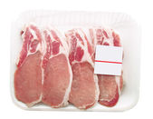 Pork chops packaged in a container with a price tag — Stock Photo