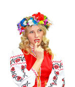 Beautiful girl in the Ukrainian national costume on a white back — Stock Photo