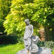 Old statue of a fountain in a shady park — Stock Photo