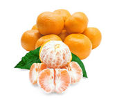 Whole and peeled tangerines on a white background — Stock Photo