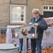 Father shows his son device pillory in the Dutch suburb. Netherl - Stock Photo