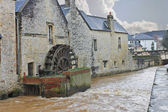Old mill on river in the town of Bayeux. Normandy, France — Stock Photo