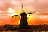 Windmill at sunset. Dutch landscape — Stock Photo