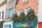 Decorative Christmas trees on a house facade in Chartres, France — ストック写真