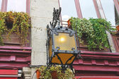 Lantern on the facade of old French house — Stock Photo