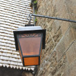 Stock Photo: Lantern on facade of old French house