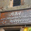 Hotel signboard in the yard abbey of Mont Saint Michel. Normandy — Stock Photo