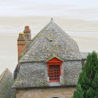 House at the abbey of Mont Saint Michel. Normandy, France - Stock Photo