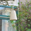 Bird feeders in a spring town — Stock Photo