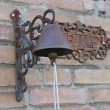 Old door bell on a brick wall at home — ストック写真