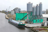 Ship in harbor of the cement plant. Netherlands — Stock Photo