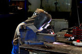 Welder working in production workshop on a workbench — Stock Photo