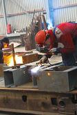 Welders work in the factory floor — Stock Photo