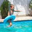 Preschool boy are jumping to the swimming pool — Stock Photo