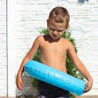 Serious kid wants to jump into swimming pool — Stock Photo #28753365