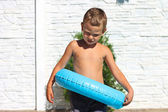 Serious kid wants to jump into a swimming pool — Stock Photo