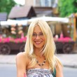 Portrait of smiling girl in a summer town — Stock fotografie