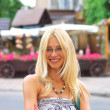Portrait of smiling girl in a summer town — Stockfoto