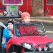 Two brothers are driving red car — Stock Photo #29129649