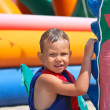 Kid in swimming vest at water park — Stock Photo #29866449