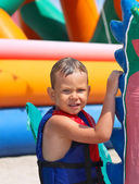 Kid in the swimming vest at a water park — Stock Photo