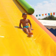 Enthusiastic kid on slide in the waterpark — Stock Photo