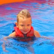 Stock Photo: Kid in vest at pool water park