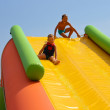 Enthusiastic kids on slide in the water park — Stock Photo